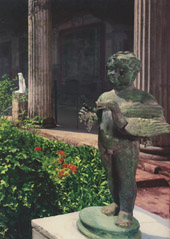 A small bronze statue in a Roman  home in Pompeii