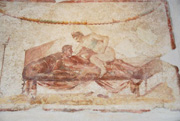 Erotic scene painted above the doorway of the room in the brothel