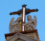 The cross on the top of the Basilica