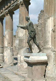 The bronze statue of Apollo near the portico of the sacred area