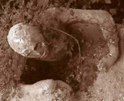 A plaster cast of a man dieing a lingering death in Pompeii