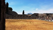 Pompeii ruins and, in the background, the Vesuvius